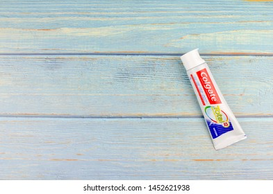 Puchong, Malaysia - July 16, 2019; Colgate toothpaste on wooden background. Brand of produced by Colgate-Palmolive.