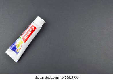 Puchong, Malaysia - July 17, 2019; Colgate toothpaste on black background. Brand of produced by Colgate-Palmolive.