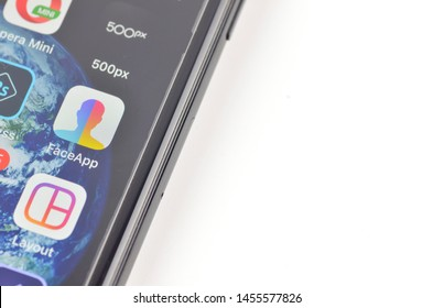 Puchong, Malaysia - July 19, 2019; iPhone 7 plus showing its screen with FaceApp - Al Face application on white background.