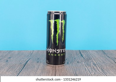 Puchong, Malaysia - March 06, 2019; A can of Monster Energy Drink on wooden surface. Introduced in 2002 Monster now has over 30 different drinks with high a caffeine content. Selective focus.