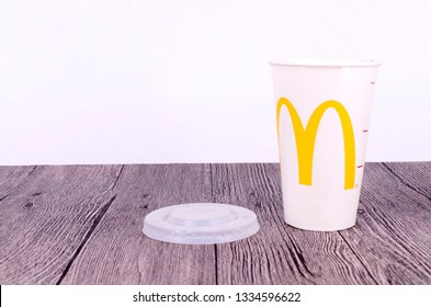 Puchong, Malaysia - March 10, 2019; McDonald's soft drink paper cop on wooden background. Selective focus.