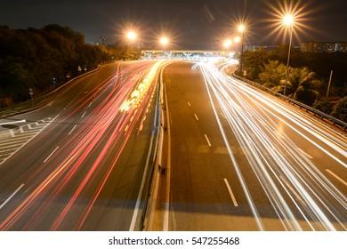 PUCHONG, MALAYSIA - OCTOBER 2016: Night trail at Puchong Jaya LDP road near new light railway transit station.