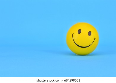 PUCHONG, SELANGOR, 25 JULY, 2017: Image of a yellow ball with Smiley face (smiley).On blue background.