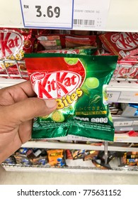 Puchong, Selangor, Malaysia- 1st December 2017; Hand holding a Nestle KIT KAT wafer chocolate bites packet in the supermarket.Mobile photoghpy.