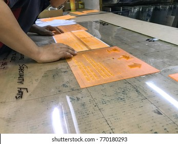 Puchong, Selangor, Malaysia- 2nd December 2017; workers are putting flexo printing plate.