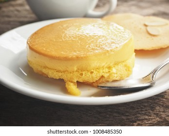Pudding cake with coffee cup