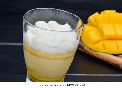 Pudding of mango fruit in a glass on table