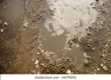 Puddle and mud with tire track texture
