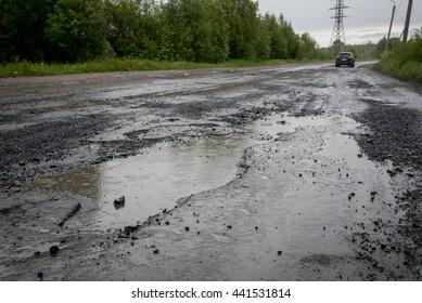 puddle (pothole) on the road, rainy weather