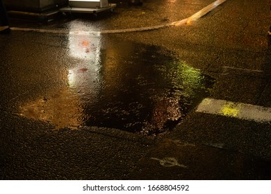 a puddle of rain in the night