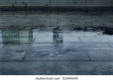 Puddle of Water in Rainy Day.
