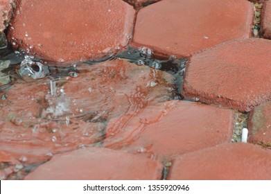 puddles in paving blocks