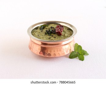 Pudina chutney or mint chutney, a traditional, popular and healthy vegetarian side dish for items like chapati or paratha.