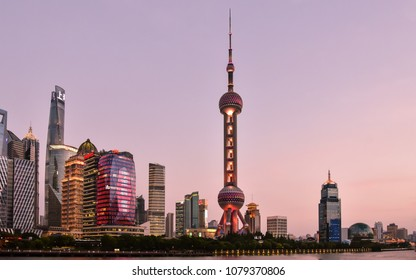 Pudong, Shanghai/China - Apr. 24, 2018: Early evening view of modern high rises in the New Pudong district, with the iconic Orient Pearl tower in center, Shanghai, China.
