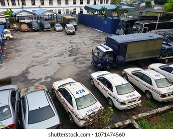 Pudu, MY - MARCH 31, 2018: Many rusty cruched police cars and vans are parking in the police station's car graveyard.