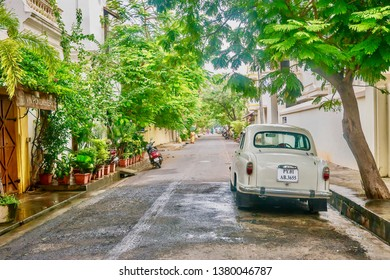 Puducherry, India - December 9, 2013. A beige vintage Ambassador car is parked on a street in the White Town area of the former French colonial town, previously called Pondicherry.