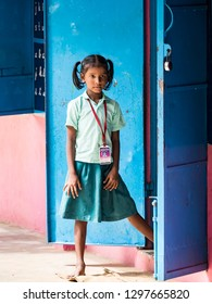 PUDUCHERRY, INDIA - DECEMBER Circa, 2018. Portrait of unidentified child teenager girl at governement school with uniform, with sad anxiety abandoned expression. Poverty solitude emotion concept.