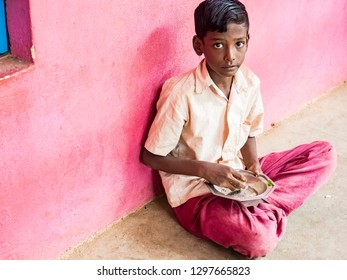 PUDUCHERRY, INDIA - DECEMBER Circa, 2018. Portrait of unidentified child teenager boy at governement school with uniform, with sad anxiety abandoned expression. Poverty solitude emotion concept.