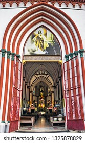 Puducherry, India - January 27th, 2019 : The entrance door of Basilica of the Sacred Heart of Jesus situated on the south boulevard of Pondicherry in Puducherry, India-specimen of Gothic architecture.