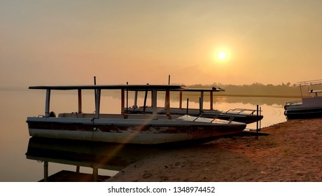Puducherry, India - March 23, 2019: A beautiful sunrise at the Ousteri lake boat house in Puducherry.