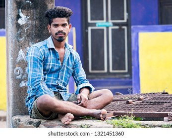 PUDUCHERY, INDIA - DECMEBER Circa, 2018. Portrait of unidentified Indian Young adult in the street of poor village looking at the camera