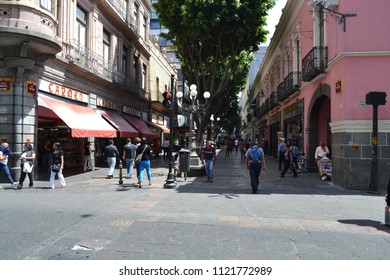 Puebla de Zaragoza, Puebla/Mexico- 03/18/2013: Shoppers stroll along a busy shopping street inside a pedestrian zone in Puebla.