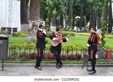 Puebla de Zaragoza, Puebla/Mexico- 04/13/2013: 3 street musicians wait for their next performance in Puebla's zocalo.