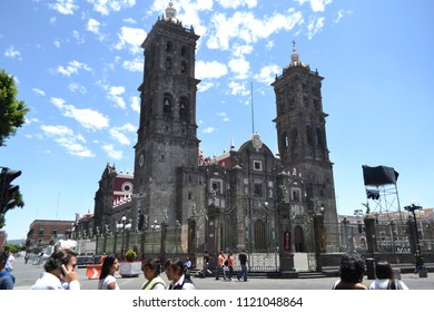 Puebla de Zaragoza, Puebla/Mexico- 04/13/2013: People walk past the imposing facade of Puebla Cathedral.