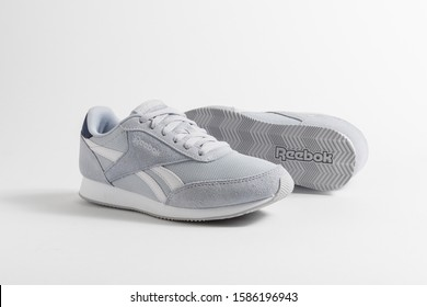 PUEBLA, MEXICO - DECEMBER 12, 2019: REEBOK men's sports shoes in gray on a white background