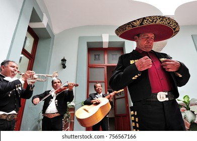PUEBLA, MEXICO - FEB 25 2010 :Mariachi band play mexican music in Puebla, Mexico. It's Mexican musical tradition that dates back to the 19th century