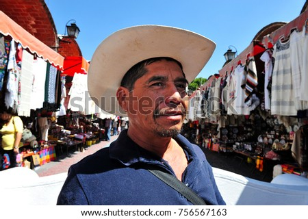PUEBLA, MEXICO - FEB 25 2010: Mexican man at the Artist Market in Puebla City, Mexico. In 2015, 21.5% of Mexico's population self-identified as being Indigenous or partially Indigenous.