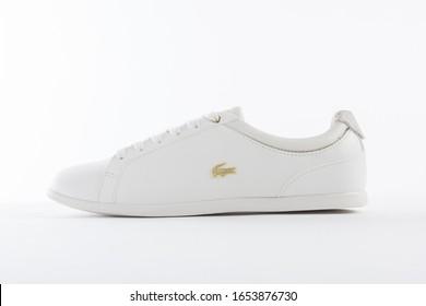 PUEBLA, MEXICO - FEBRUARY 10, 2020: White LACOSTE sneakers on white background