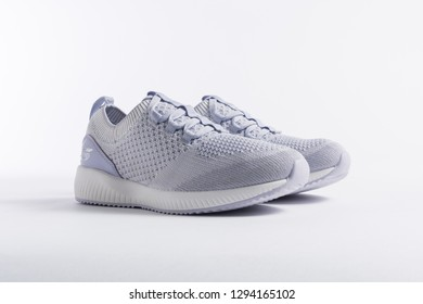 PUEBLA, MEXICO - JANUARY 23, 2019: SKECHERS comfortable tennis shoe for woman isolated on white background - Image