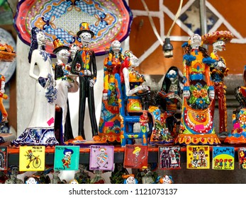 PUEBLA, MEXICO - June 1, 2018: Colorful Mexican souvenirs and skeleton figurines for sale at a market in Puebla, Mexico.