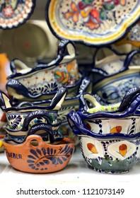 PUEBLA, MEXICO - June 1, 2018: Colorful Mexican talavera pottery for sale in a souvenir shop in Puebla, Mexico. Talavera ceramic is mostly used to make utilitarian items such as plates, bowls, jars.
