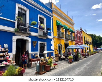 Puebla, Mexico - June 2, 2018: Bright and colorful facades of colonial buildings and houses in historic center of Puebla.