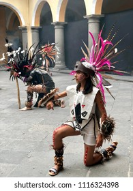 PUEBLA, MEXICO: June 2, 2018: Mexican Concheros dancers dressed in traditional feathered regalia and headdress during a ritual  dance performance.