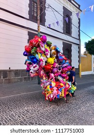 PUEBLA, MEXICO - June 2, 2018: Balloon vendor with many colorful balloons for sale.