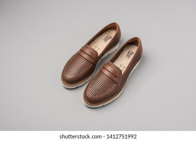 PUEBLA, MEXICO - MAY 31, 2019: FLEXI shoes on gray background with shadows and artificial light