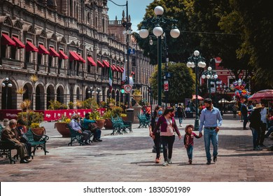 Puebla, Mexico - October 9, 2020: Zocalo of the city of Puebla in the new normal, families walking without healthy distance