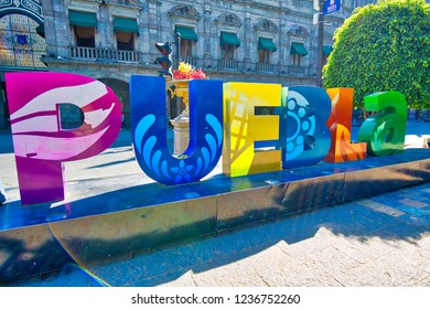 Puebla, Mexico-18 April, 2018: Puebla streets in historic city center, big letters displaying a city name at a central Zocalo plaza