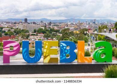 Puebla sign over looking the vibrant Puebla City in Mexico - Puebla, Mexico - 3 August 2018