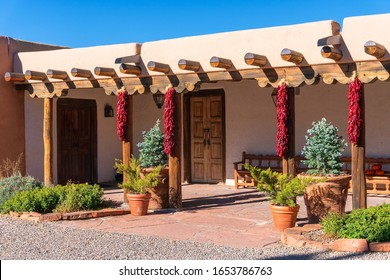 Pueblo style adobe architecture home  with ristras in Santa Fe, New Mexico