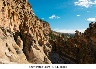Puebloan ruins and volcanic tuff rock formations at Bandelier National Monument in New Mexico