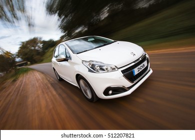 Puente Arce, Spain - November 4, 2016: White Peugeot 208 driven on national road.