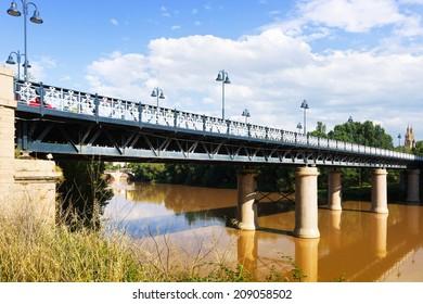 Puente de Hierro  over Ebro river in sunny day. Logrono