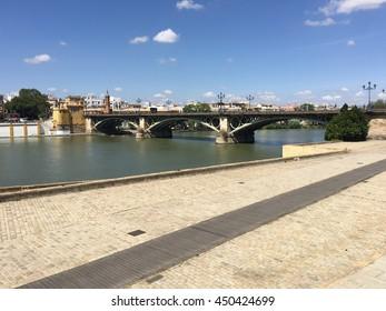 Puente de Isabel II Bridge over the Canal de Alfonso XIII in Seville Spain