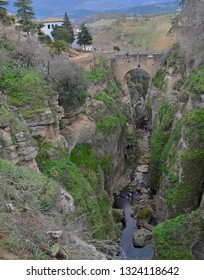 Puente Viejo (Old Bridge) in Ronda Spain with view of the river Tajo and valley below from the Jardines De Cuenca
