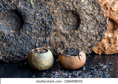 Puer raw tea. Pu-erh in different sorts and shapes. Tea cakes texture and orange tea made in traditional chinese way. Popular antioxidant drink from China.