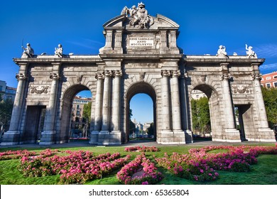 """The Puerta de Alcala is a monument in the Plaza de la Independencia (""""Independence Square"""") in Madrid, Spain.  It was commissioned by King Carlos III, with construction beginning in 1778."""